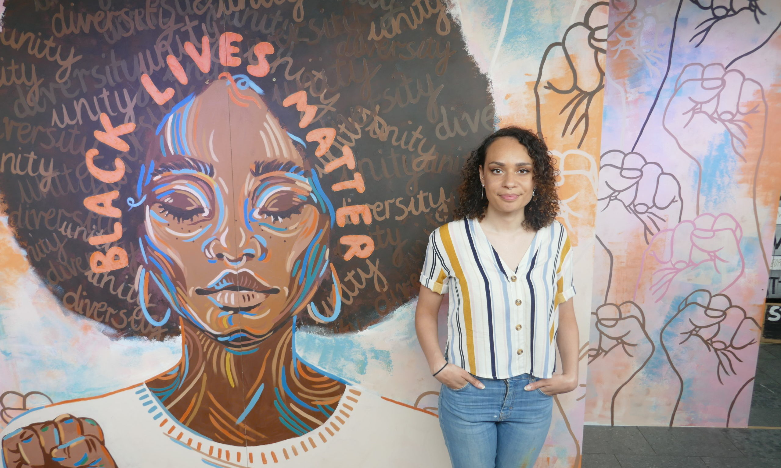 Local illustrator Jacqueline Briggs next to the finished piece