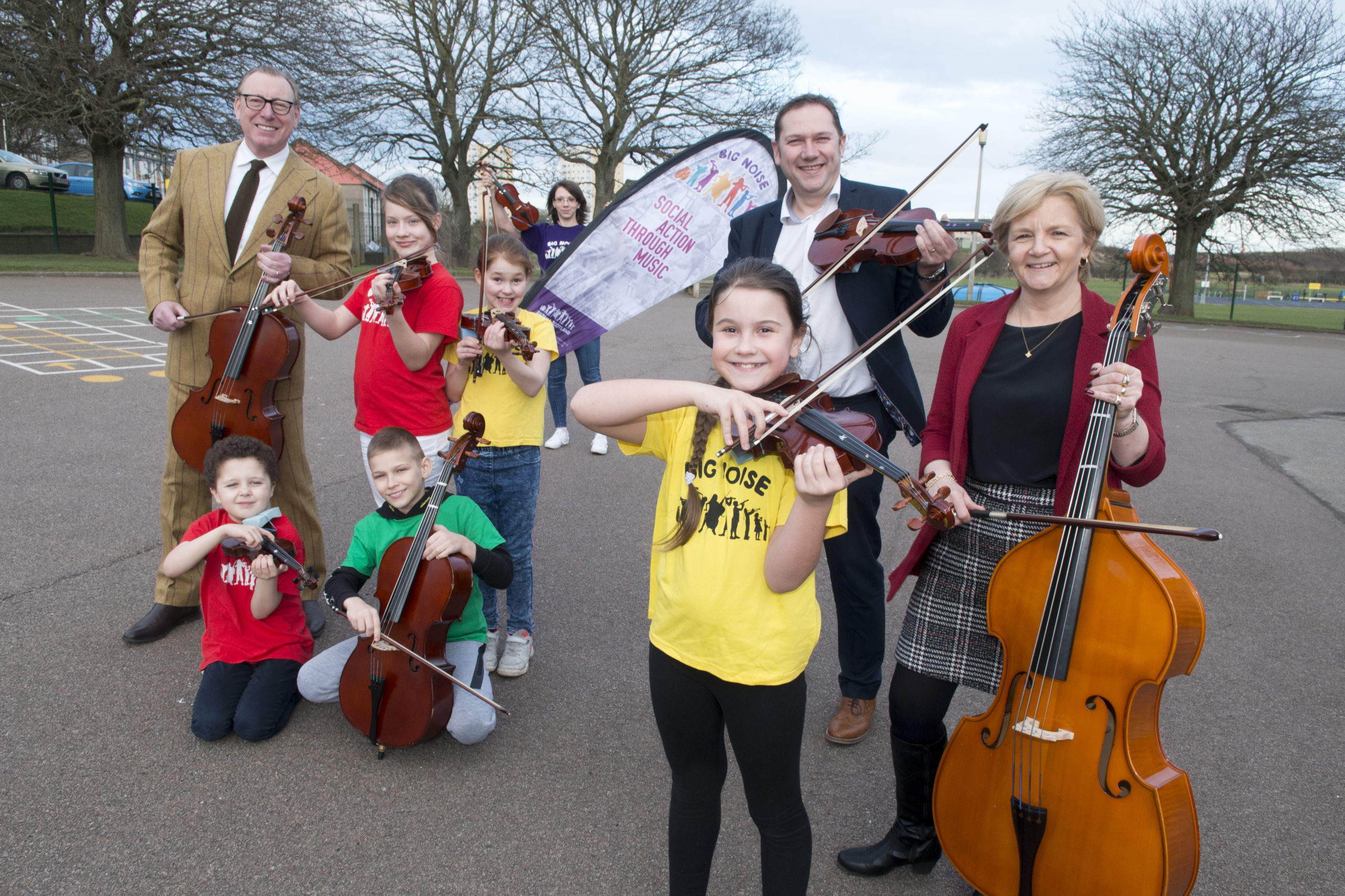 L-R: Benny Higgins, Councillor Douglas Lumsden and Councillor Jenny Laing with children from Big Noise Torry.