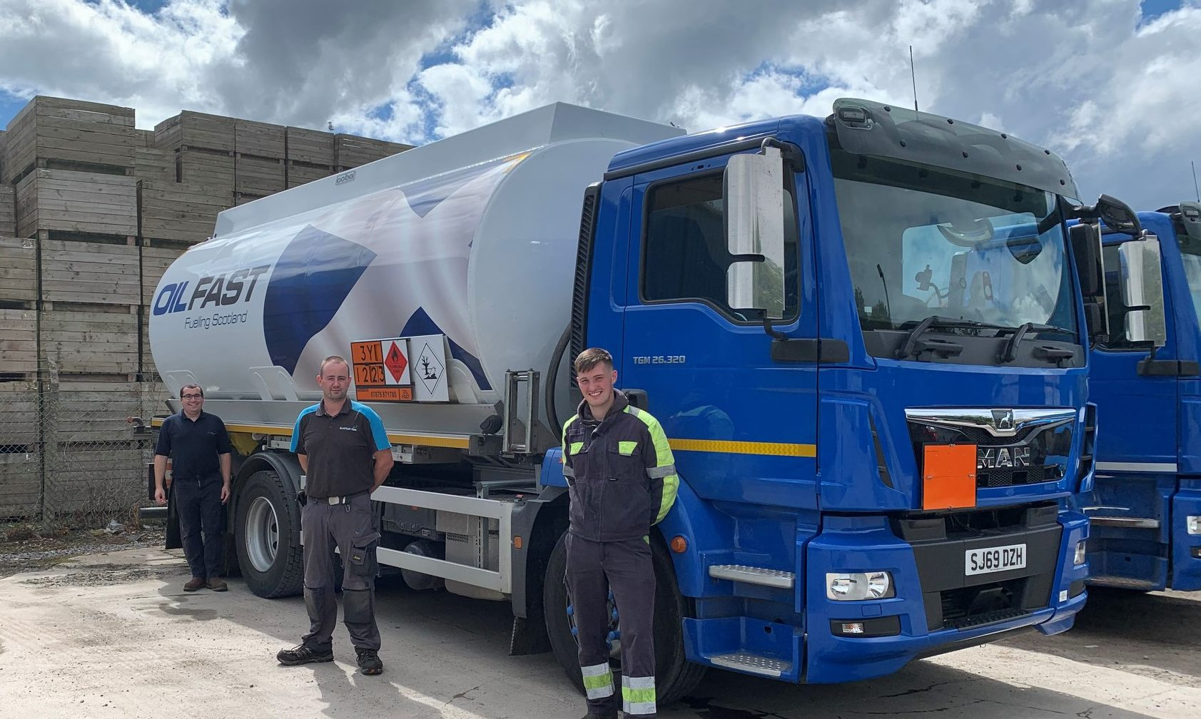 (Left) Carl Stewart with Account Manager Tommy Fraser and Tanker Driver Steven Sharpe from Inverness Depot.