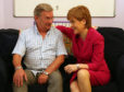 "First Minister Nicola Sturgeon with Michael Brown, who successfully campaigned for a woman's ""right to know"" after his daughter was murdered by an ex-partner with a violent past."