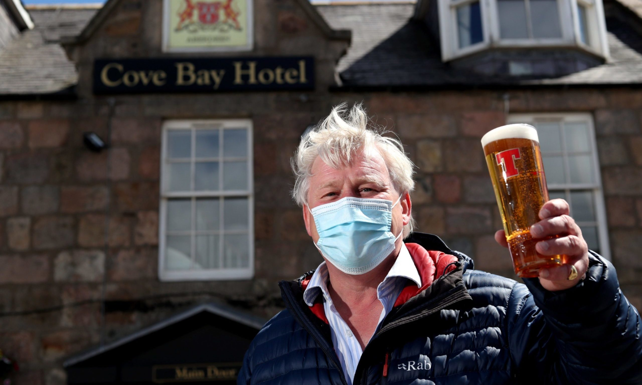 Guy Craig, Owner of the Cove Bay Hotel welcomes people to his new beer garden