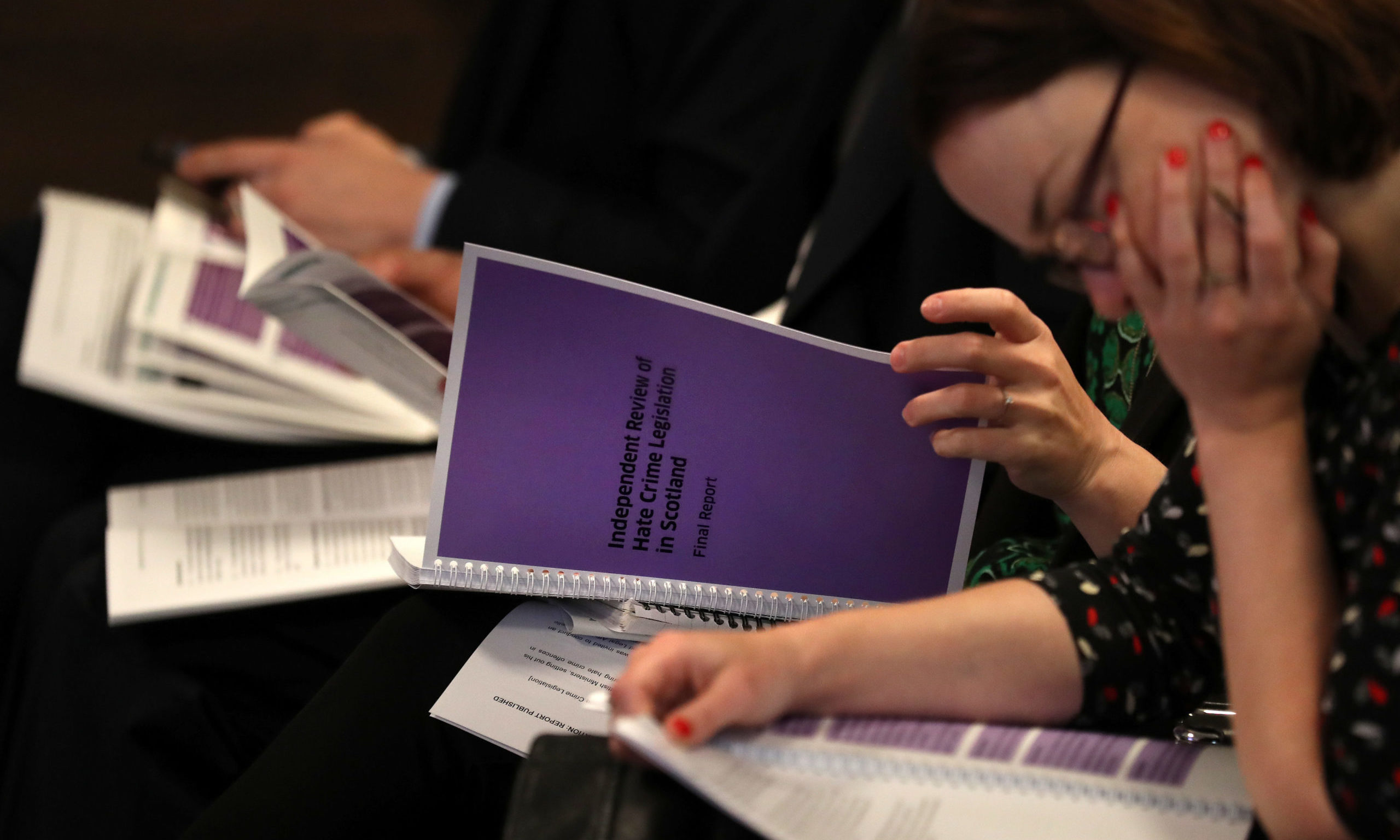 Journalists read copies of Lord Bracadale's report on his Independent Review of Hate Crime Legislation at its publication in Edinburgh.
