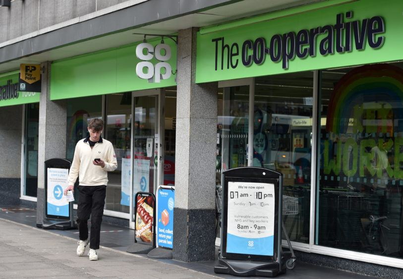 Shoppers leaving The Co-operative on Union Street, Aberdeen. Picture by Darrell Benns.
