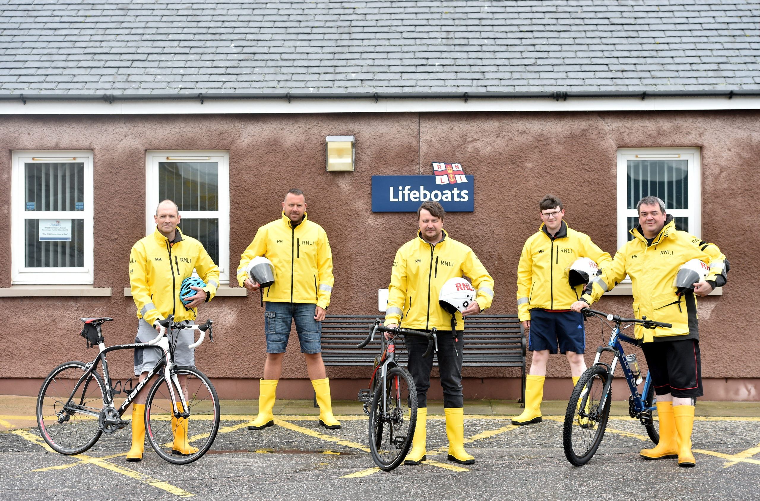 Pictured are the RNLI volunteers from left, Andy Simpson, George Rhind, Craig Aird, Gordon MacLeod and Michael Ritchie at Peterhead Lifeboat RNLI Base. Picture by DARRELL BENNS