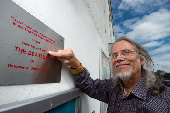 Music writer David Dills outside the former Two Red Shoes in Elgin, where The Beatles performed in 1963.