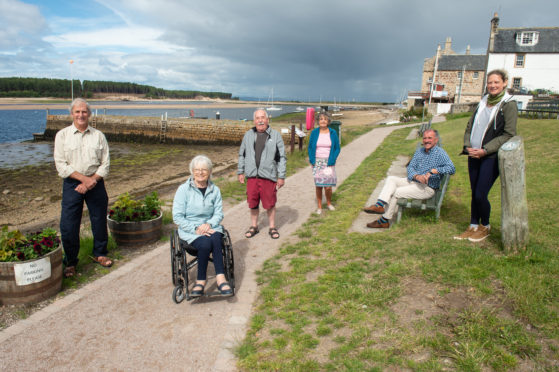 The Findhorn Village Conservation Company has completed a path in memory of local businessman David Urquhart. Pictured: Working group member Donald Watson, local residents Eleanor McDonald and  Stewart McDonald, working group members Joan Miller and Frank Allan, landscape architect Katherine Wolf. Picture by Jason Hedges.