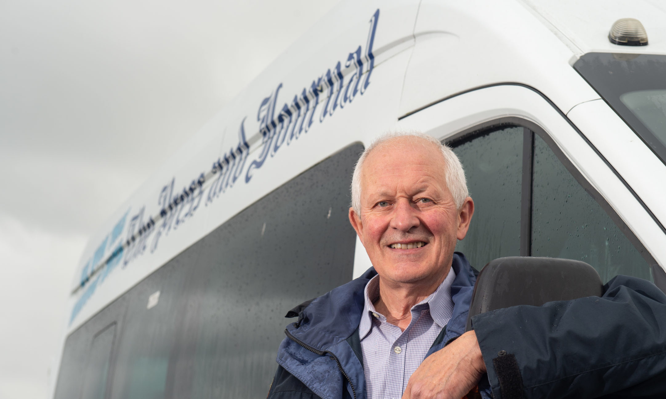 Jim Patterson, a member of Burghead and Cummingston Community Council, with the minibus won from the P&J. Picture by Jason Hedges.