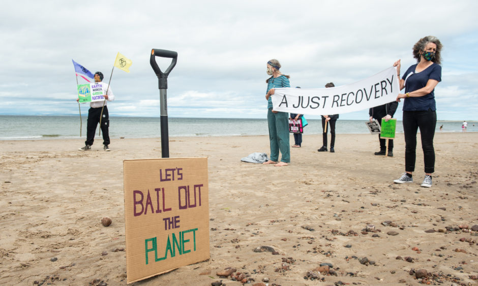 Extinction Rebellion protesters at Nairn beach. Pictures by Jason Hedges.