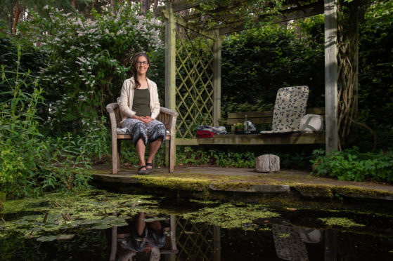 Psychotherapist Julia Lay within her tranquil therapy garden for client use. Pictures by Jason Hedges.