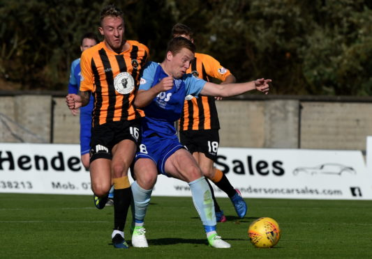 Berwick's Daryl Healy and Peterhead's Scott Brown in action.  Picture by KENNY ELRICK     22/09/2018