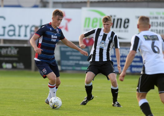 Joel MacBeath, left, in action for Ross County.