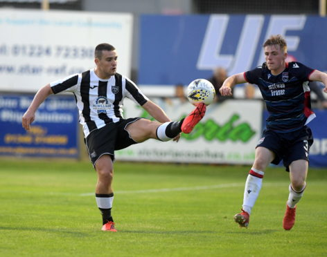 Fraserburgh's Scott Barbour and Ross County's Josh Reid. Picture by KATH FLANNERY