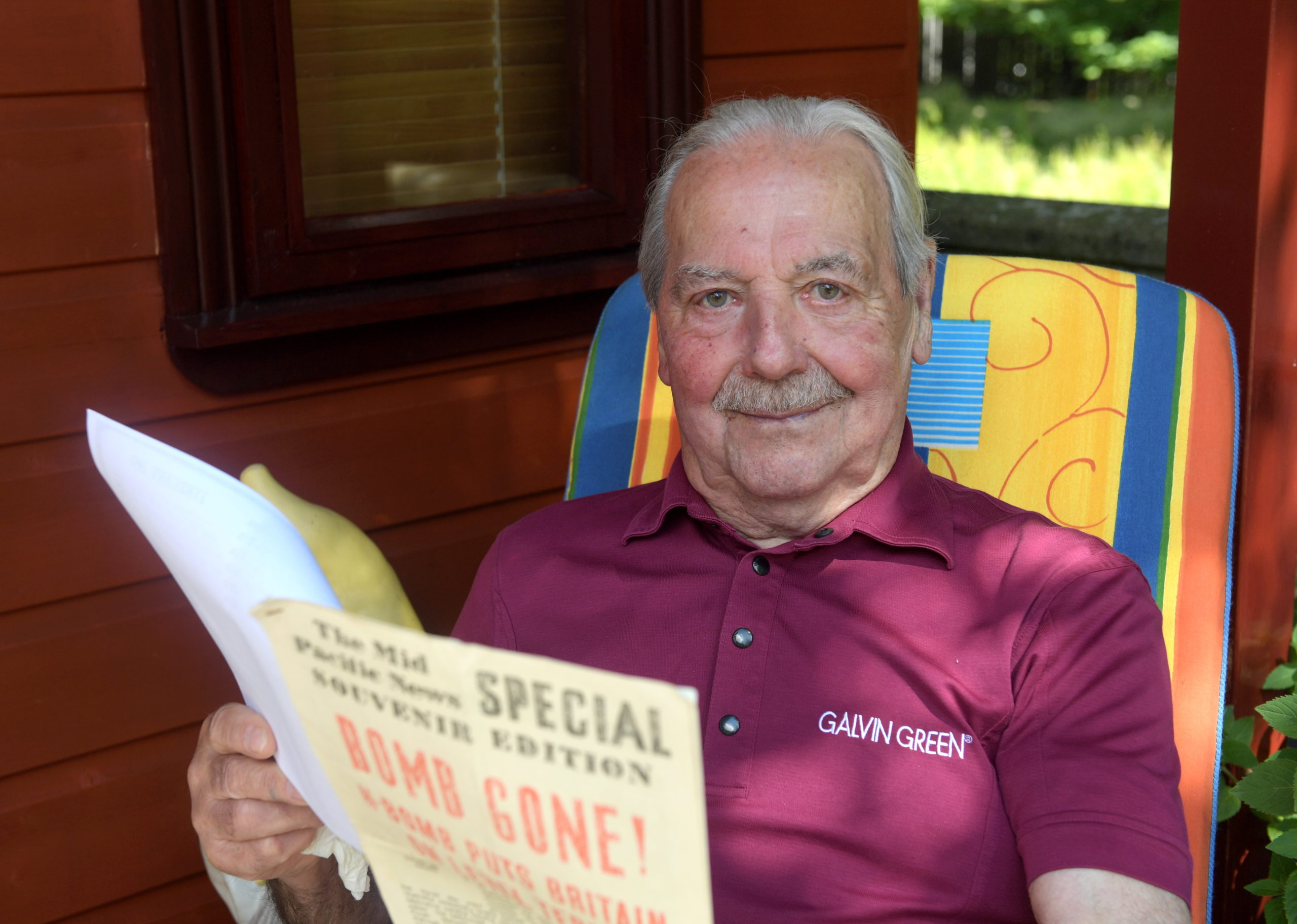 Navy veteran Ron Campbell pictured with his memorabilia and navy diary.  Picture: Kath Flannery