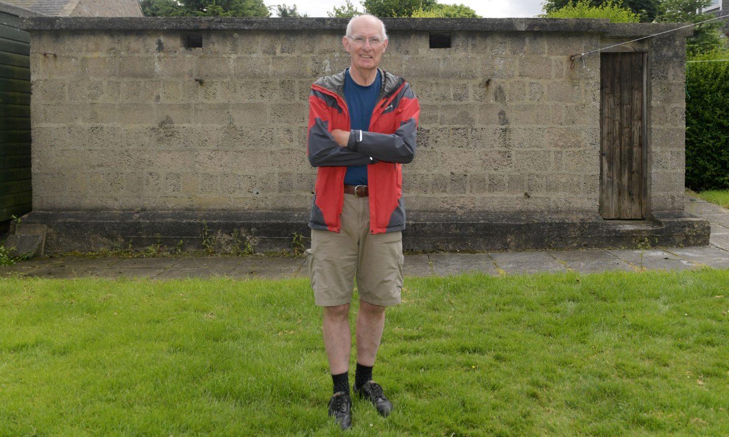 Allan Paterson at his air raid shelter.