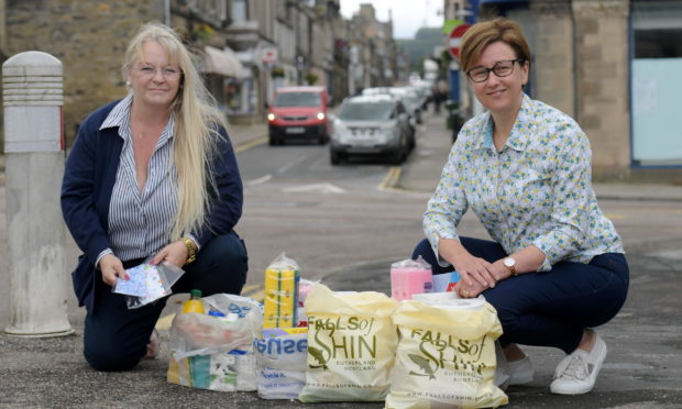 Karen Pryce-Iddon and Esther Green with care packages. Picture by Kath Flannery.