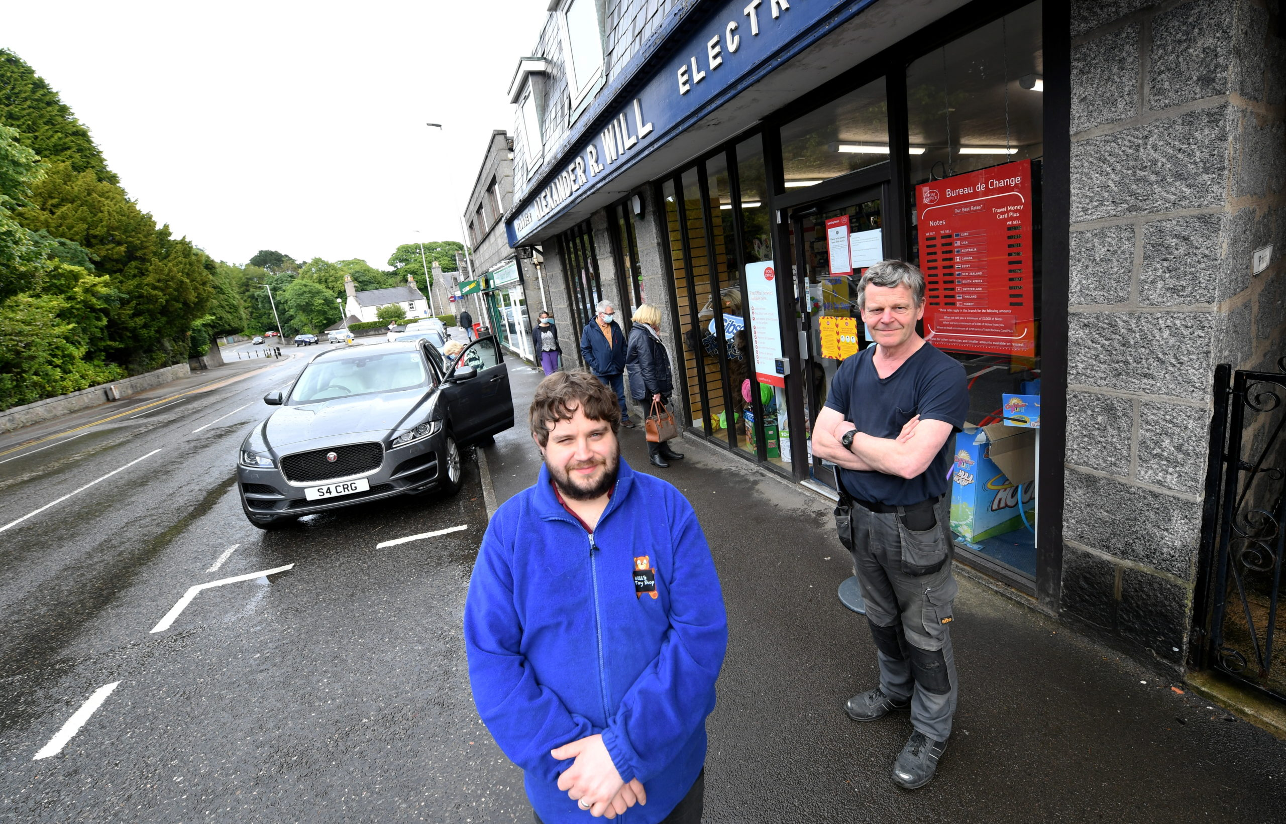 Brendan Will (left) at the store in Cults with his father Martin (right).
