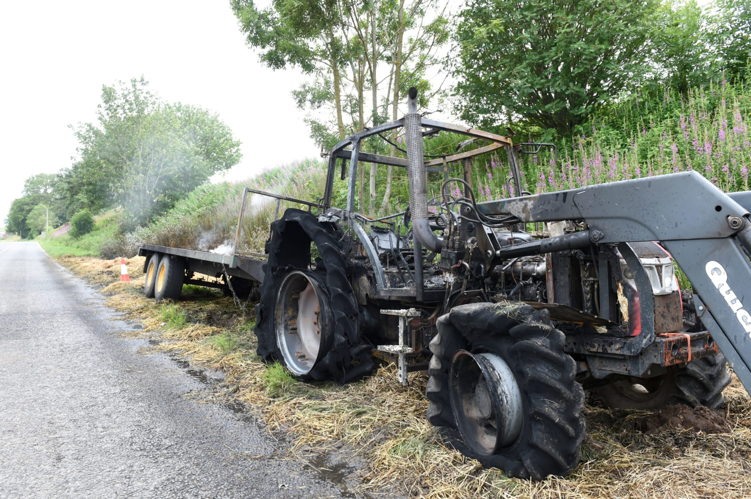 Tractor fire on the A947. Picture by Paul Glendell