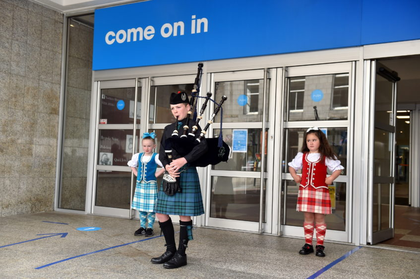 A piper and Highland dancers outside The Trinity Centre in Aberdeen. Picture by Scott Baxter