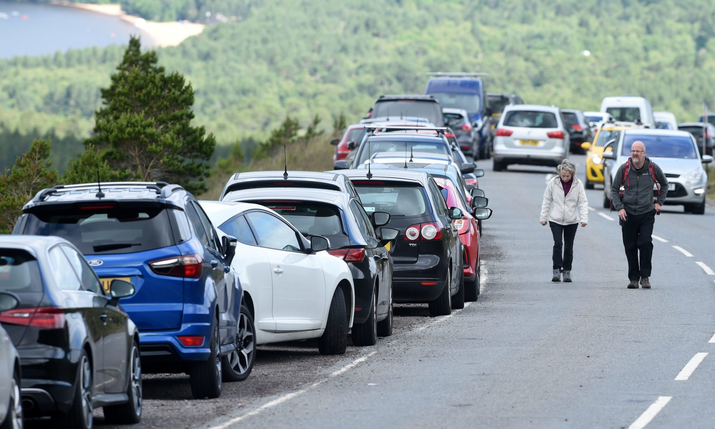 More than 100 cars and vans parked alongside and on the Cairngorm Ski Road. Picture by Sandy McCook