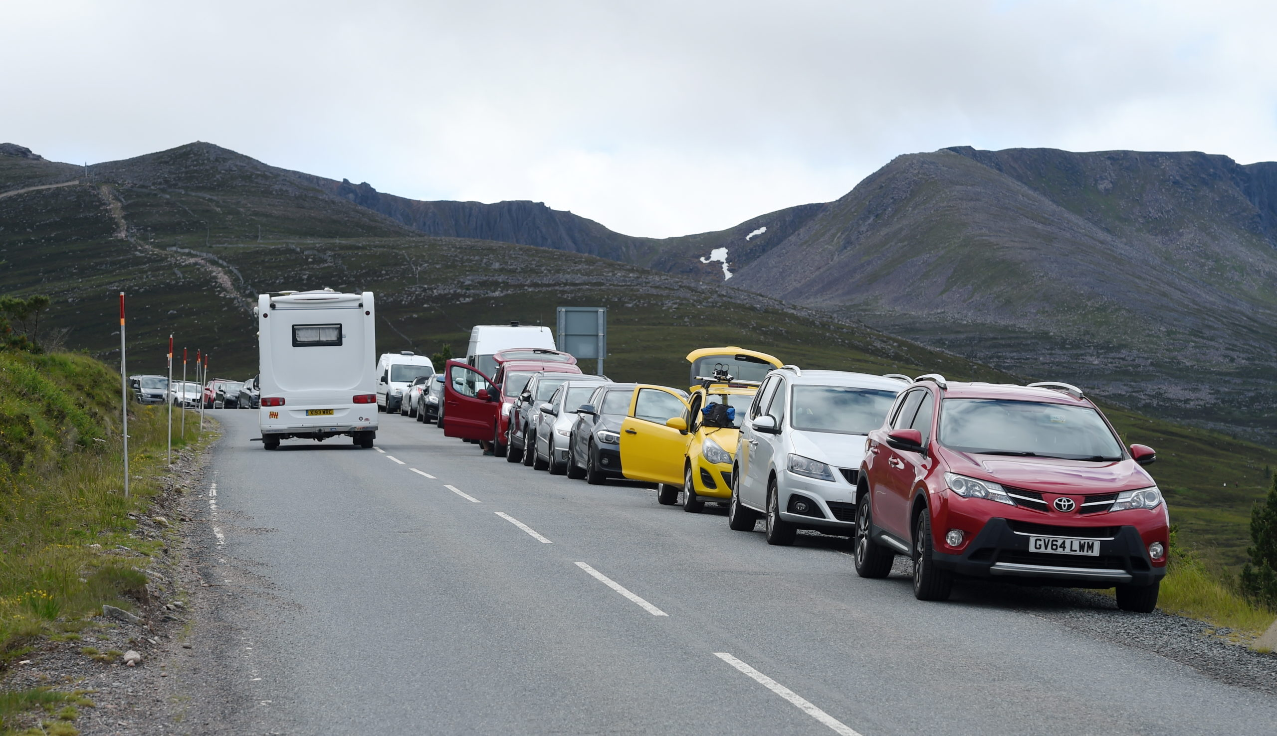 Holidaymakers use car parks as unofficial campsites with their motorhomes, caravans and tents in the Glenmore and Cairngorm areas despite toilets being closed and the Glenmore Camp Site remaining closed until next year. A line of over 100 cars and vans was parked alongsid and on te Cairngorm Ski Road from the entrance to its car park as it remains closed as a result of Covid-19.