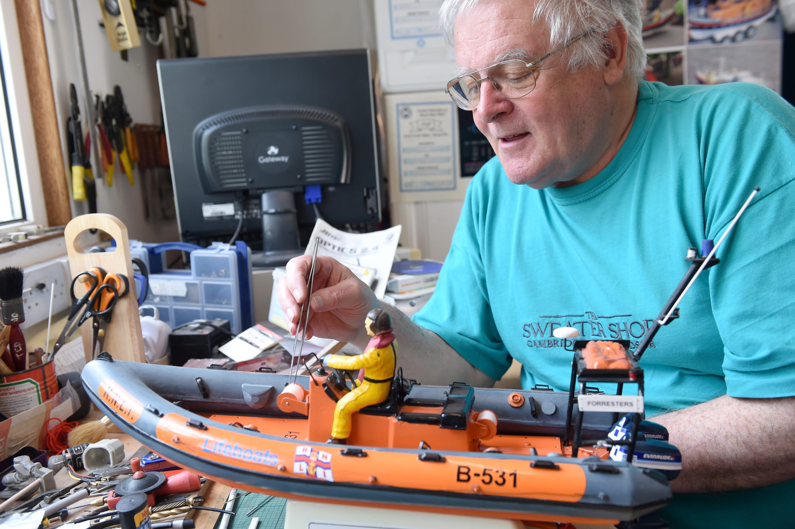 Modelmaker Ted Miller shows off his hand crafted collection of lifeboats which he has built. Picture by Sandy McCook.