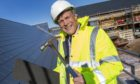 Ron Taylor fits the last slate to the roof of Parklands new Care Home at Fortrose