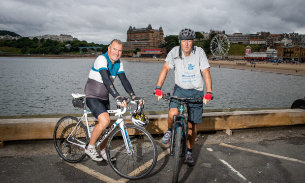 Hugh Roberts (SweetSpot Managing Director) and Robin Young pictured after the Scarborough leg of their cycle around the coastline of Britain.