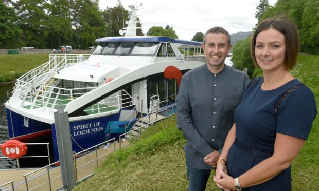 Ronald and Debi Mackenzie from Cruise Loch Ness, beside the Spirit of Loch Ness. Photo by Sandy McCook