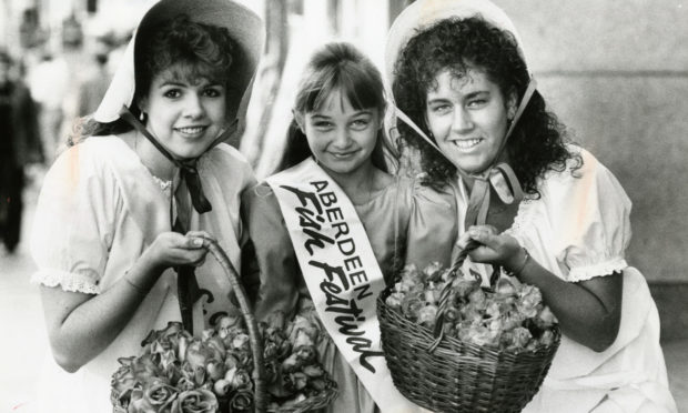 Ruth Donaldson (left) and Kay Massie, two of the Aberdeen City Centre Association Rose Princesses with Fish Festival Princess, Danielle Maloney (10). Picture taken 11 August 1990.