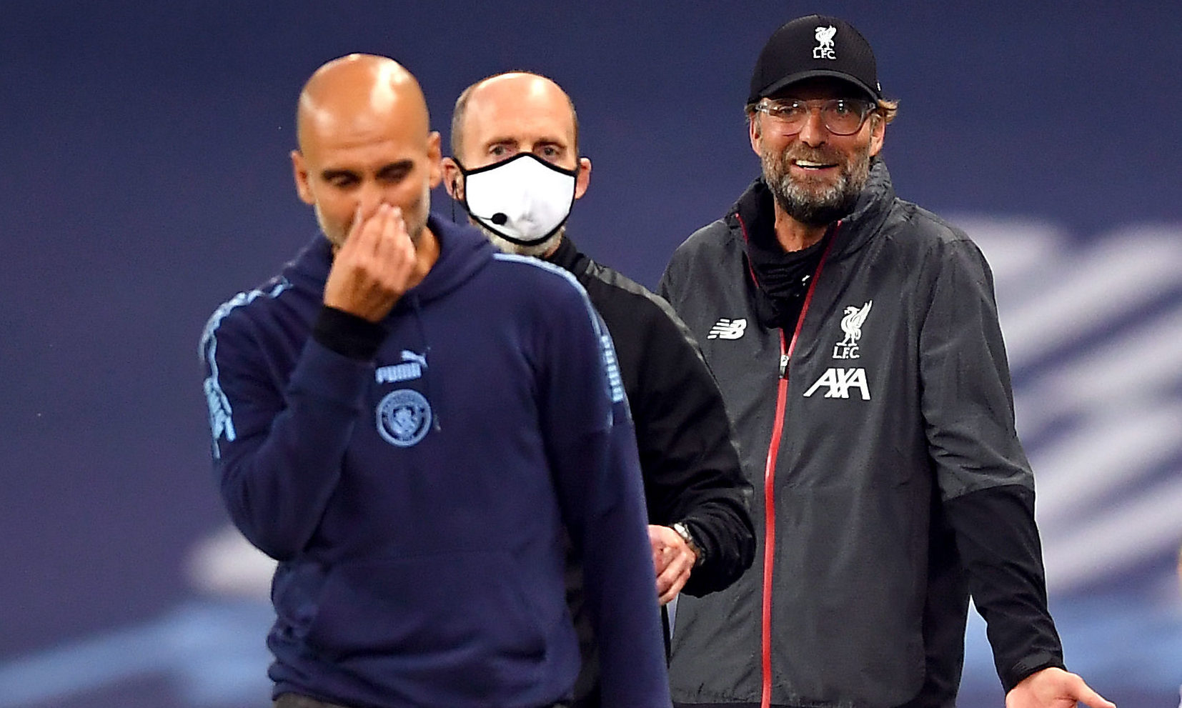 Liverpool manager Jurgen Klopp gestures towards Manchester City manager Pep Guardiola (left) on the touchline.
