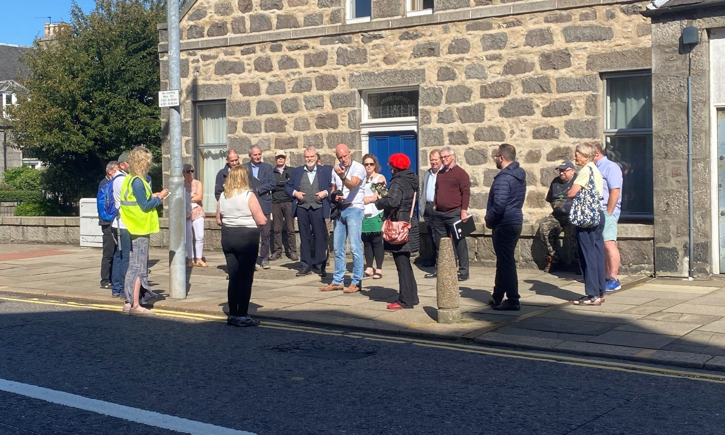 Aberdeen City Councils chief officer for capital projects, John Wilson (centre, in white) discusses the concerns of Rosemount residents and traders.