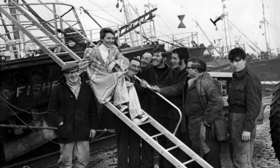 Singing star Lulu is the centre of attention as she visits Aberdeen Harbour in 1973. Lulu was in town to promote the Aberdeen production of Peter Pan in January of that year.