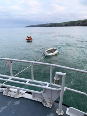The Aberdeen lifeboat had to tow the fridges back to land