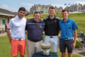 Aaron Stewart (right) and Scott Lorimer (far right) complete golfing challenge.