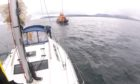 Oban lifeboat assisting a stranded yacht on the west coast.