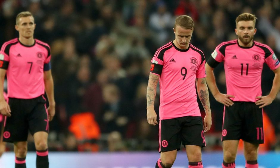 Darren Fletcher, Leigh Griffiths and James Morrison look dejected after England take the lead during a match in 2016.