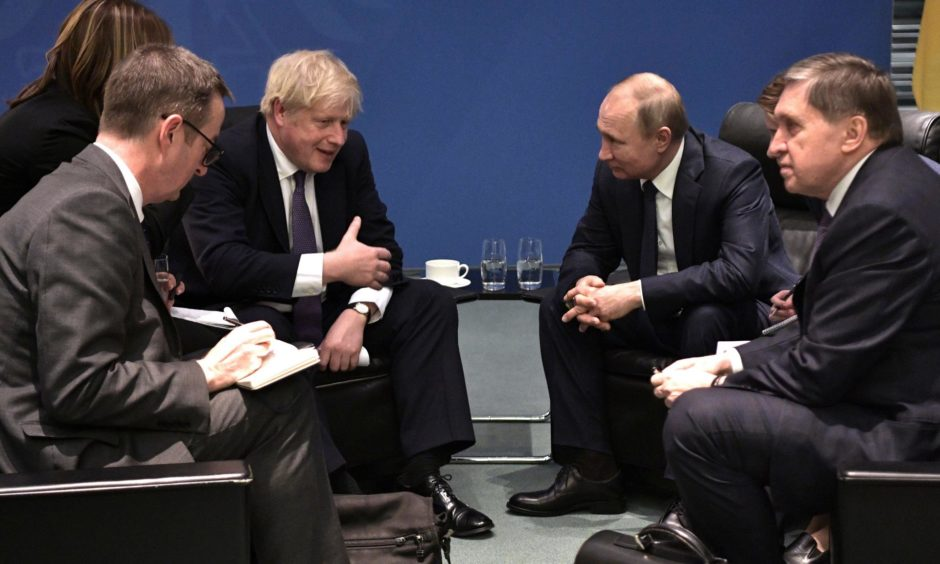 Prime Minister Boris Johnson and Russian President Vladimir Putin in 2019.