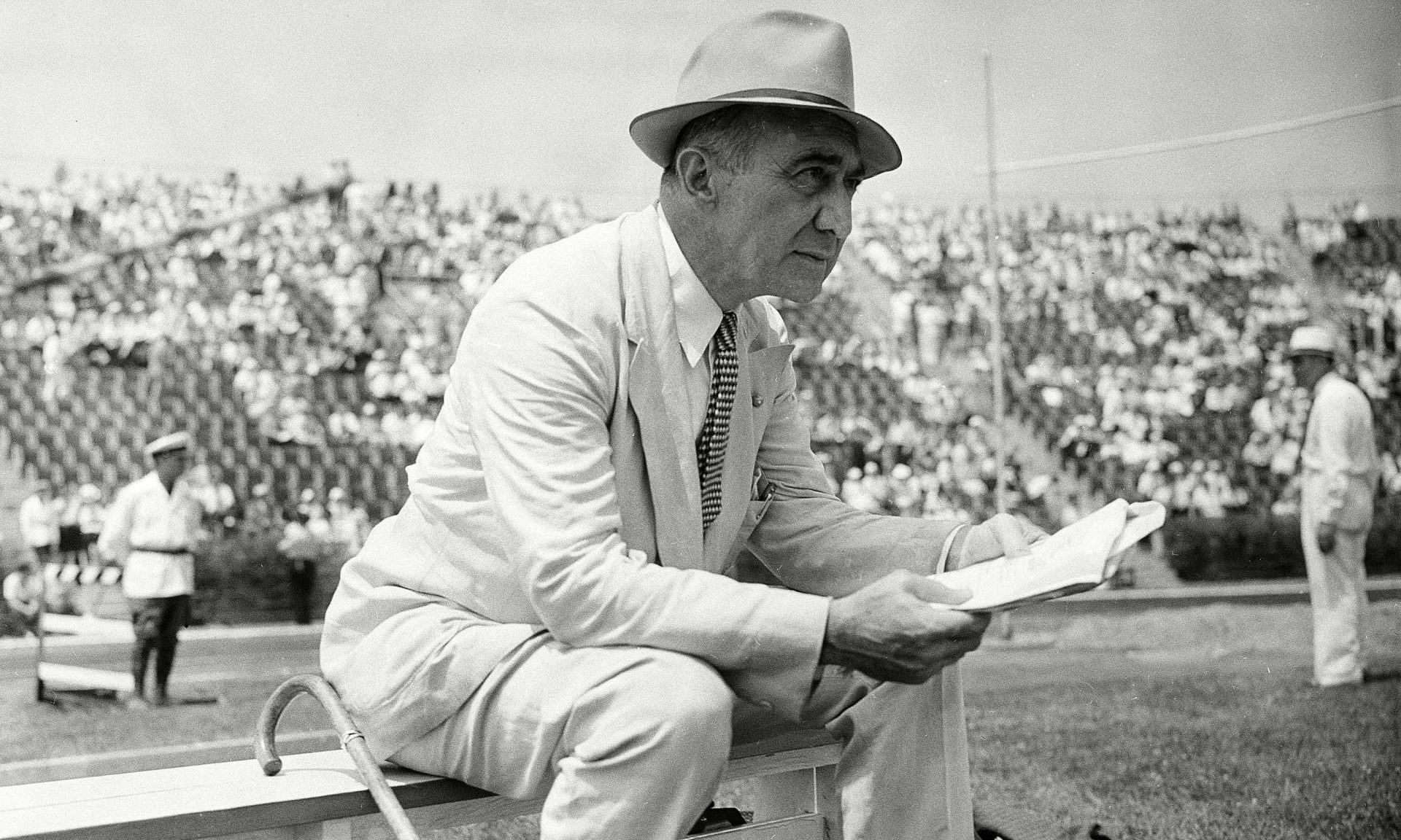 Coach Lawson Robertson of the United States Olympic team as he watches one of the field events in the final Olympic tryouts in New York City.
