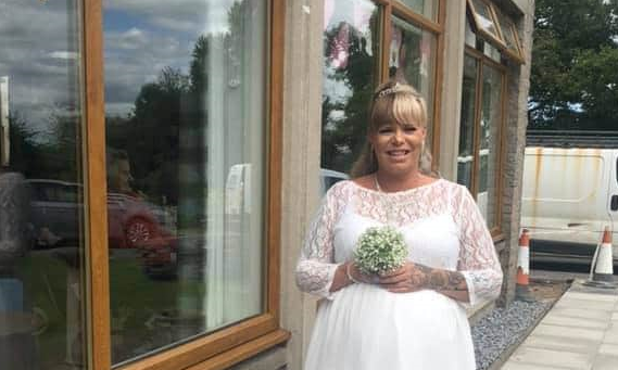 Amanda Leil surprised residents at Keith care house by arriving in her wedding dress.