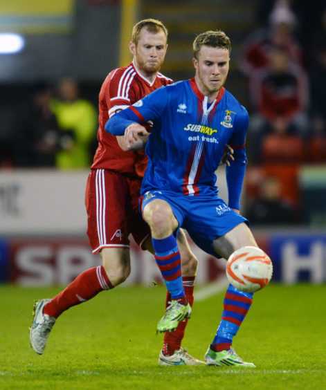 In action against Aberdeen's Mark Reynolds in April 2015.