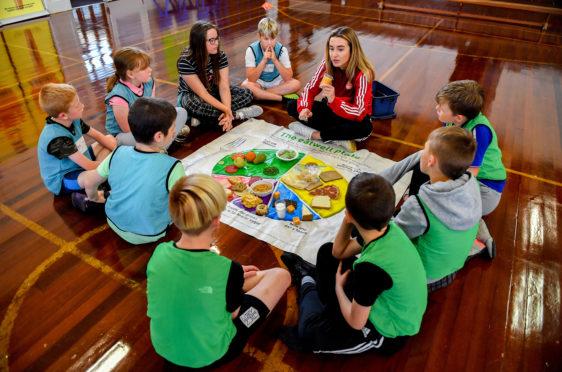 Pictured is volunteer Jenna McDonald during a Partner Schools project at Buchanhaven School in Peterhead.