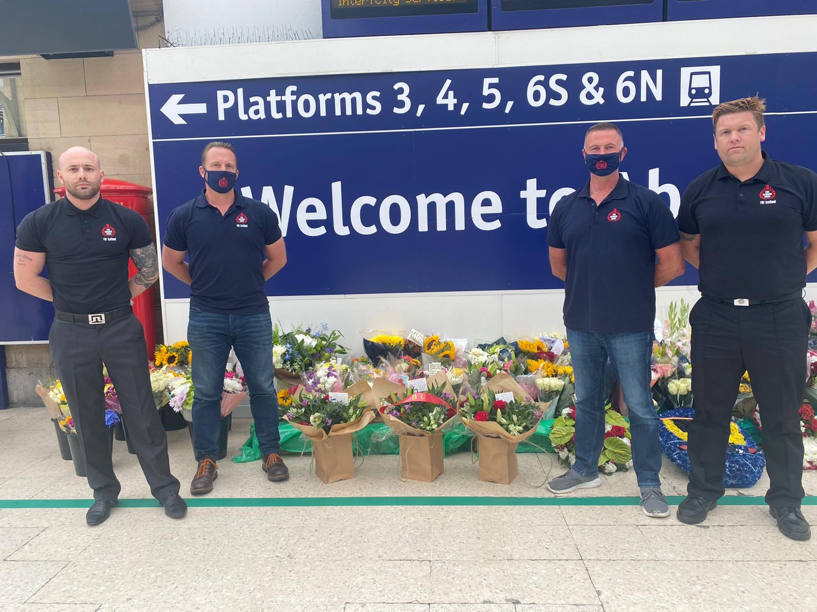 The firefighters laying flowers at Aberdeen train station