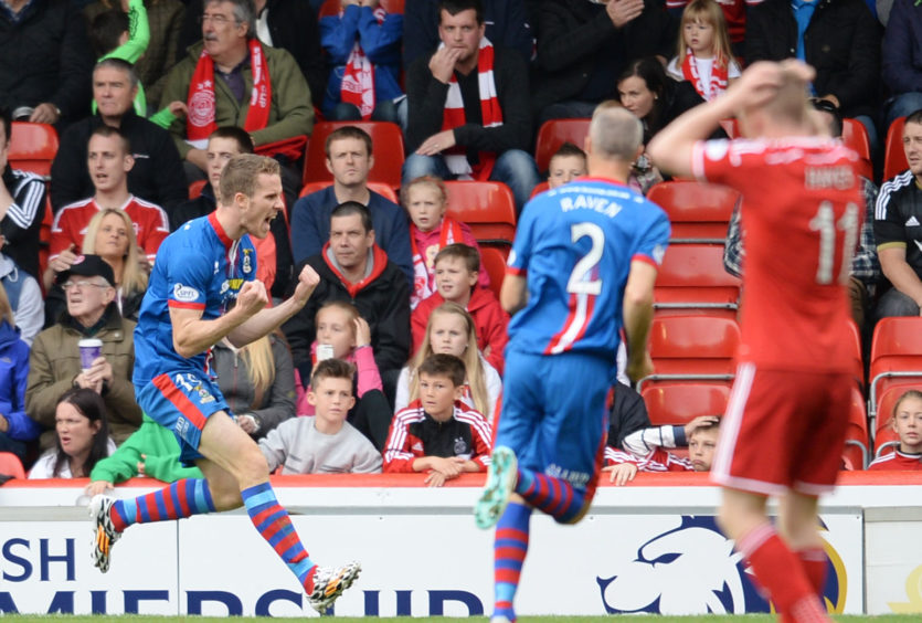 Marley Watkins celebrates after scoring against Aberdeen at Pittodrie in September 2014