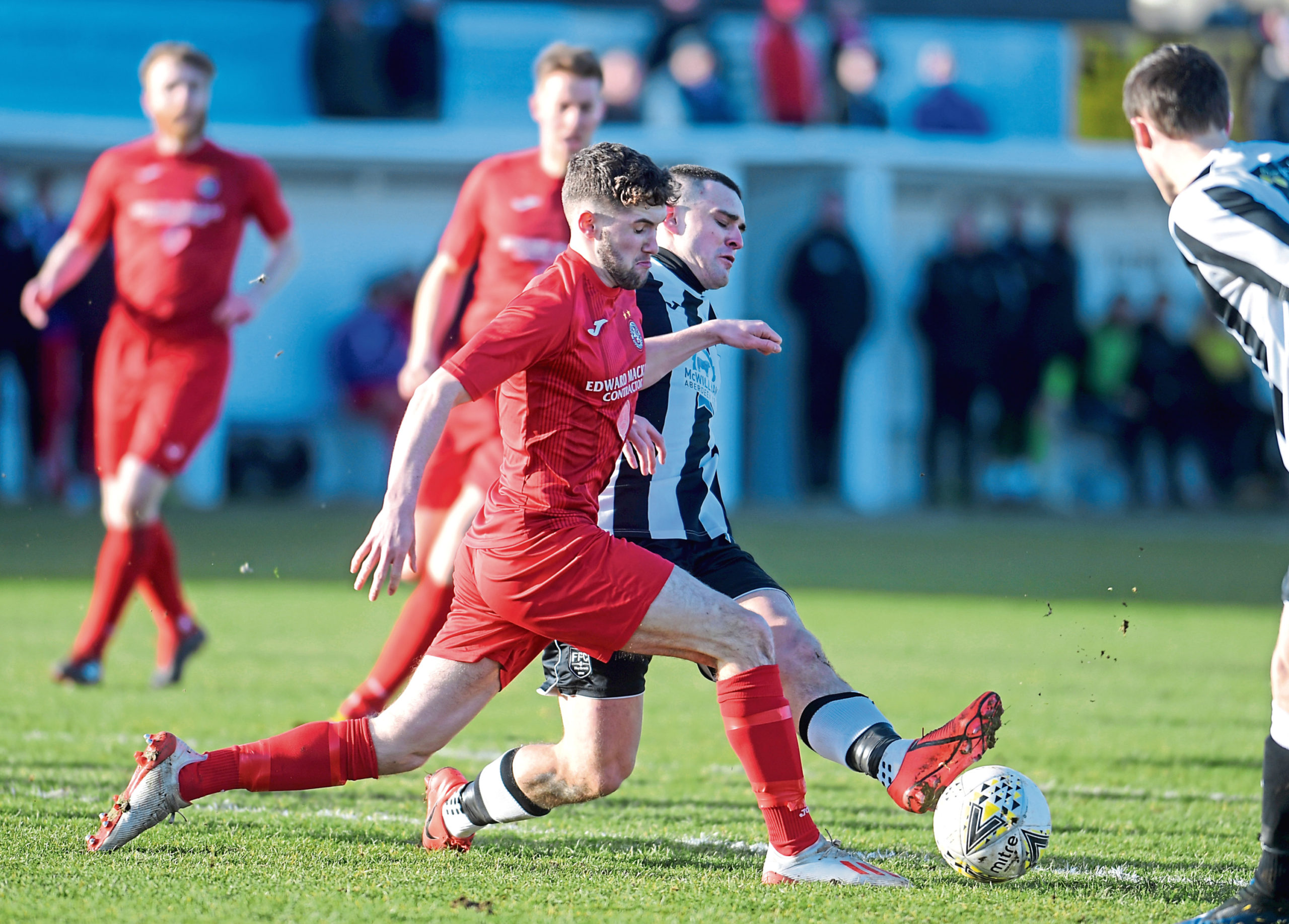 Tom Kelly playing for Brora Rangers