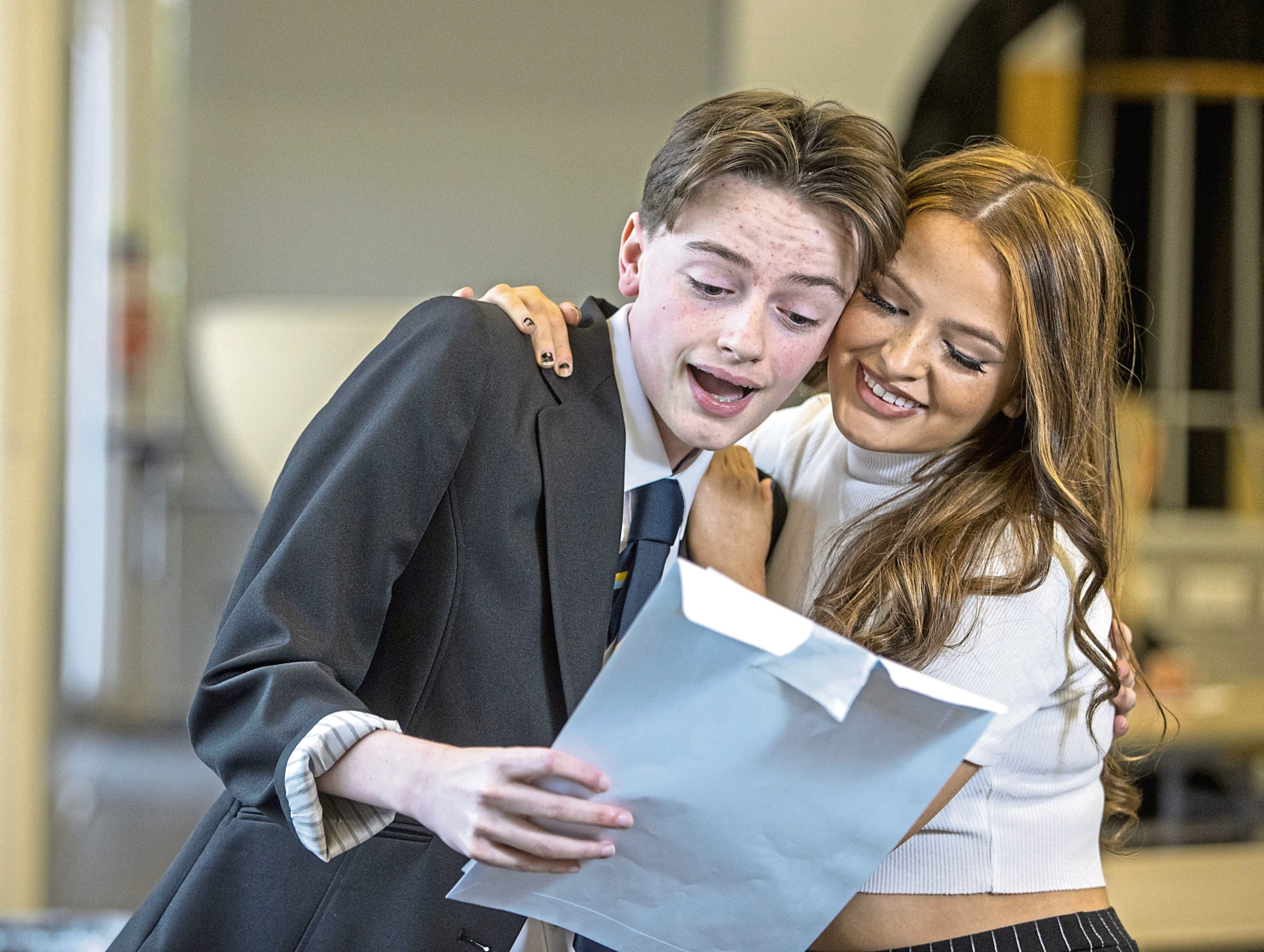 Pupils celebrating their results after an incredible year where exams were cancelled for the first time in Scotland. Picture by Jeff Holmes