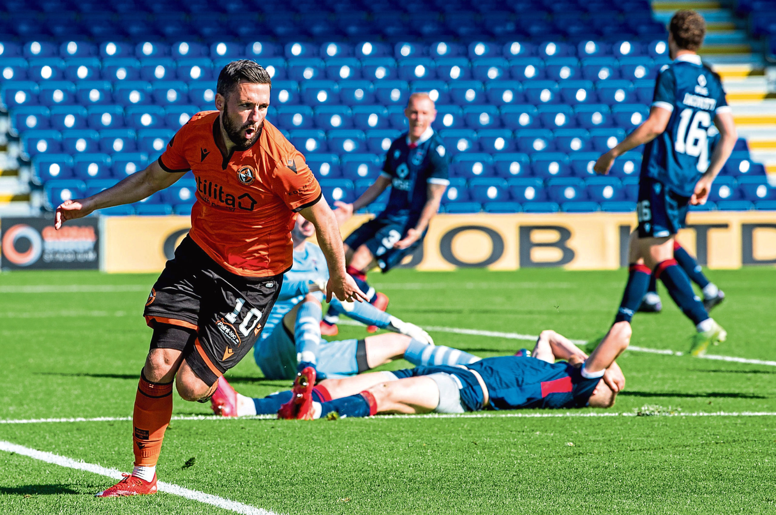 Nicky Clark celebrates his winner for Dundee United on Saturday.