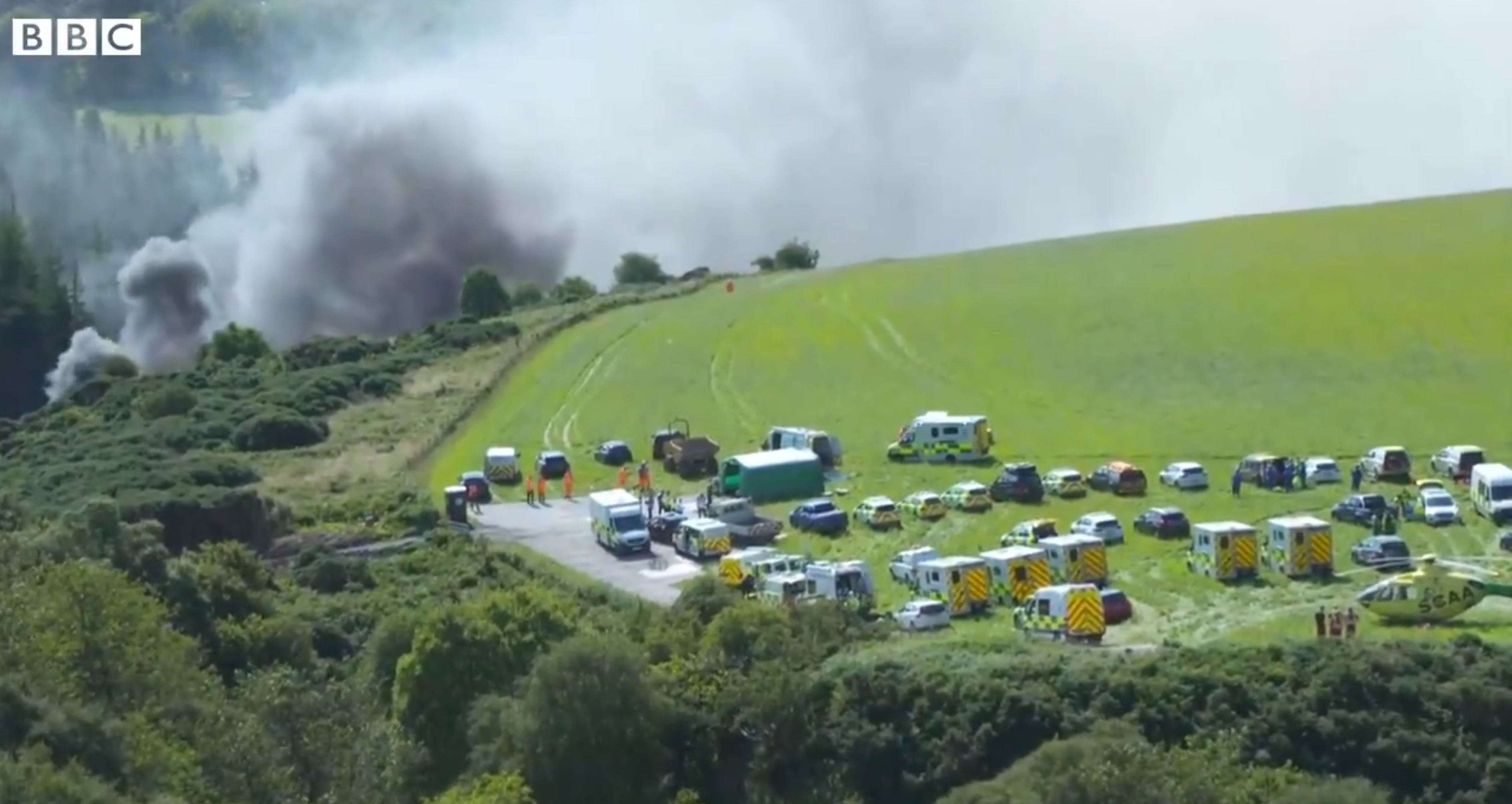 Emergency services at the scene of a train derailment near Stonehaven