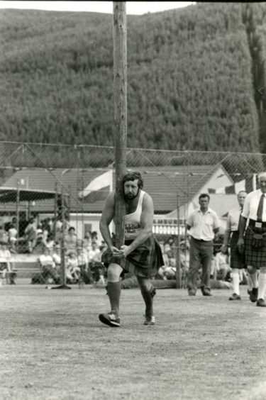 """Ballater Highland Games - """"This way up...Alan Sim, Fettercairn, sets off to toss the caber."""" Picture taken 11 August 1983."""