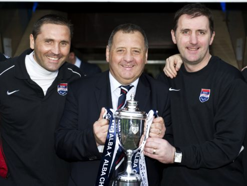 Ross County boss Jimmy Calderwood (centre) celebrates with son and assistant manager Scott (left) and coach Stuart Balmer after winning the Challenge Cup in 2011