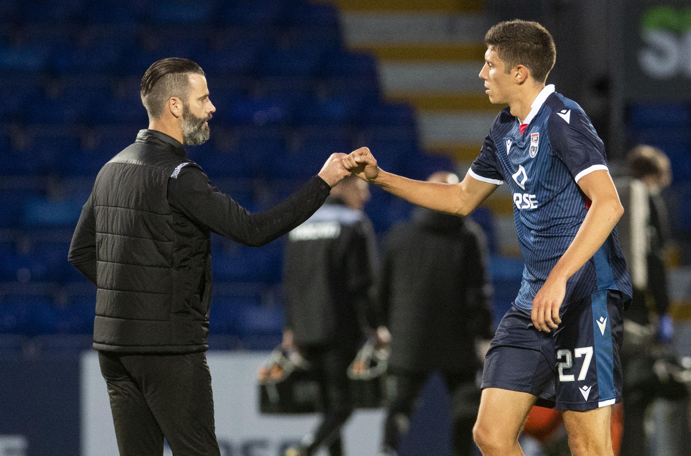 Ross County manager Stuart Kettlewell (left) congratulates goalscorer Ross Stewart at full-time.
